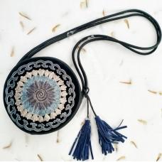 Круглая сумка из натуральной кожи синяя